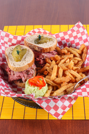 smoked meat sandwich with fries