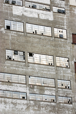 old industrial building with broken windows