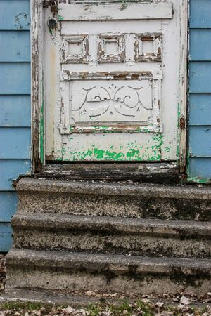 entrance door of a abandoned house Stock Photo