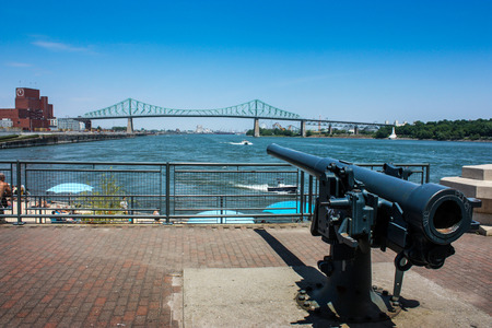 old gun pointing at the Jacques-Cartier bridge in old Montreal, Quebec, Canada