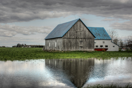 old barn by the lake Stock Photo
