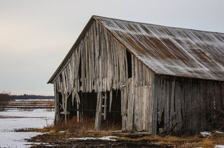 old abandoned barn in winter
