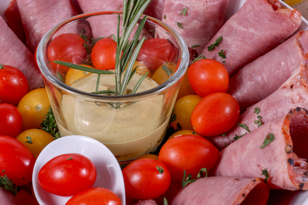 Cold Cuts Plate with tomatoes and a dip