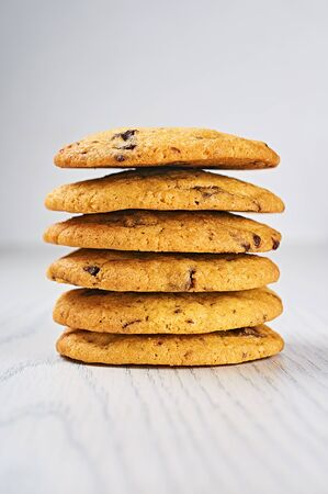 chewy: Soft and Chewy Chocolate Chip Cookies on a White Wooden Table Stock Photo
