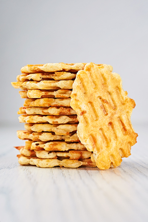 caraway: Cheese Caraway Crackers on a White Wooden Table
