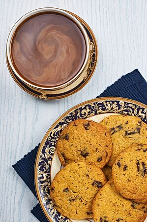 chewy: Soft and Chewy Chocolate Chip Cookies With Coffee on a White Wooden Table
