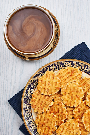 caraway: Cheese Caraway Crackers With Coffee on a White Wooden Table Stock Photo