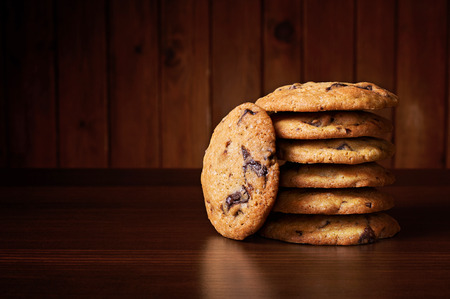 chewy: Soft and chewy chocolate chip cookies on a wooden table Stock Photo