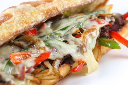 Tasty beef steak sandwich with onions, mushroom and melted provolone cheese in a ciabatta Reklamní fotografie