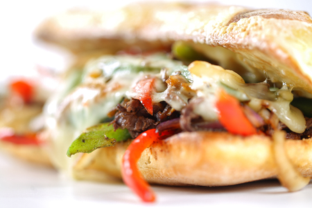 steak sandwich: Tasty beef steak sandwich with onions, mushroom and melted provolone cheese in a ciabatta Stock Photo