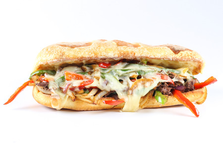 ciabatta: Tasty beef steak sandwich with onions, mushroom and melted provolone cheese in a ciabatta Stock Photo