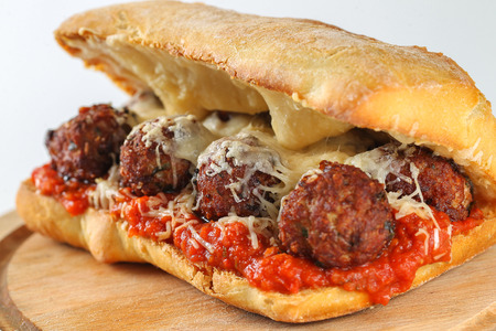 Tasty meatballs sandwich in a ciabatta with tomato sauce and parmesan