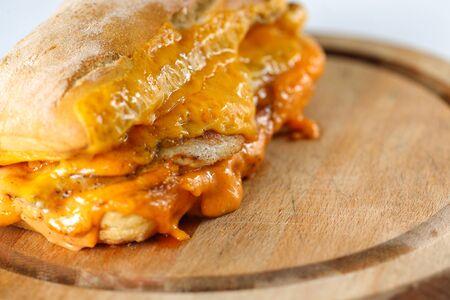 steak sandwich: Tasty chicken steak sandwich in a ciabatta with cheddar cheese and thick romanian garlic sauce