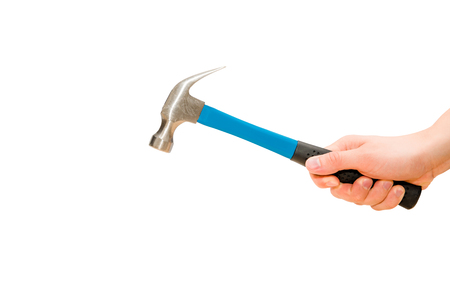 Hand holds blue hammer in action. Isolated, white background Banco de Imagens