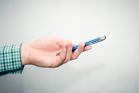 Hand hold blue pen