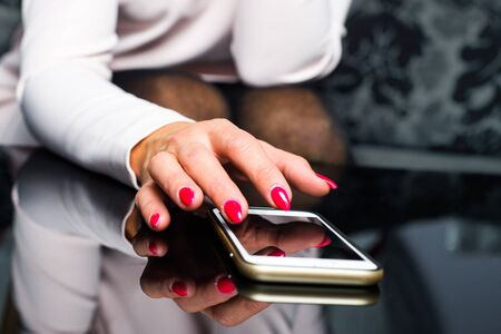 Using Your Phone. Woman Clicks On The Phone Screen. Checking.. Stock on checking document, checking time, checking data, checking phone, checking billboard s ads, checking watch, checking email, checking number, checking list, checking oil,