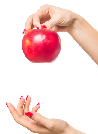Apple in hand. Time for healthy eating, for vitamins. Stock Photo