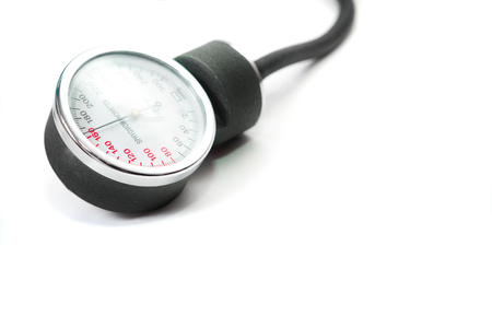 Blood pressure monitor. A classic blood pressure monitor for measuring blood pressure. Isolated, white background.