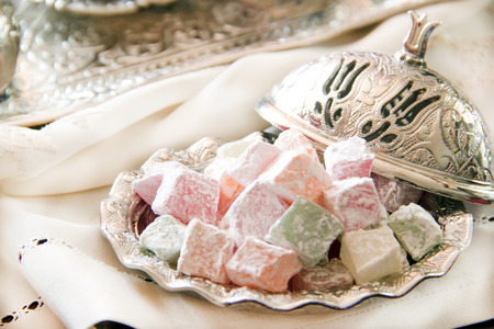 delight: Turkish delight with coffee and traditional silver serving set Stock Photo