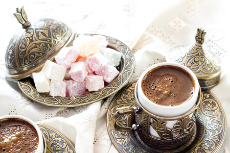Turkish coffee with delight and traditional copper serving set
