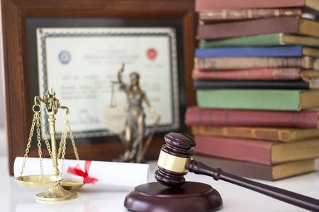 judicature: Law concept, statue, gavel, scale, books and diplomas Stock Photo