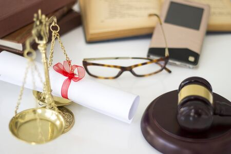 justness: Law concept, gavel, scale, boxing, mobile phone and diplomas