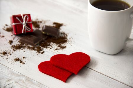 i nobody: Red hearts and gift box with chocolate and coffee on wooden table. Valentines day
