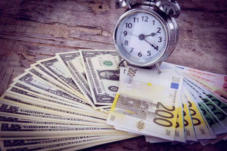 monthly salary: Business concept with money Euro and American Dollar on wooden board. Black and white Stock Photo
