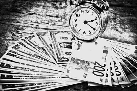 numerate: Business concept with money Euro and American Dollar on wooden board. Black and white Stock Photo