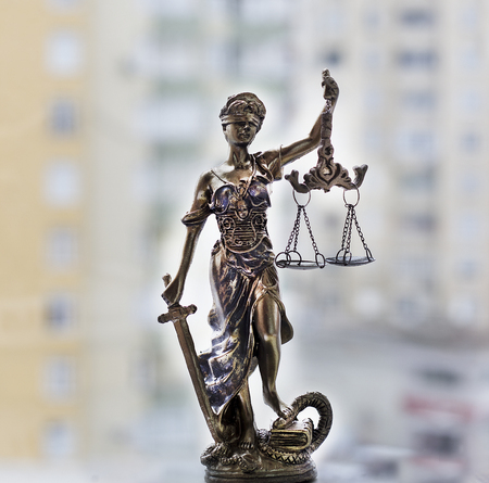 Justice statue with sword and scale. Law concept