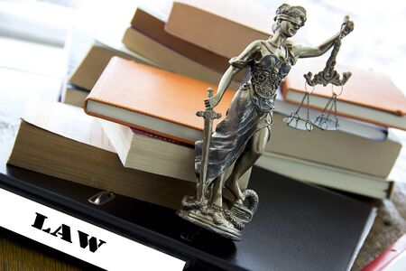 justice statue: Justice statue with sword and scale and books. Law concept Stock Photo