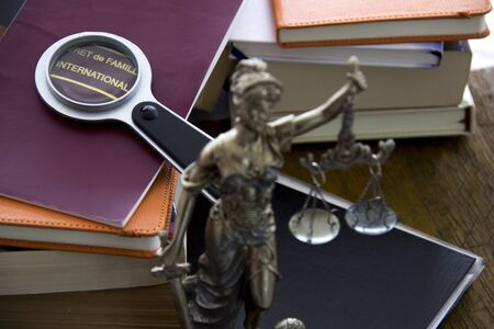 family law: Family law. Justice statue with sword and scale and marriage certificate