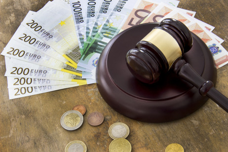 judicature: Labor law concept, gavel and money on wooden table Stock Photo