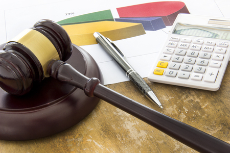 judicature: Labor law concept, laptop, gavel, calculator and money on wooden table