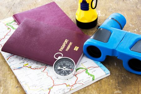 duty belt: Travel planning over world map and compass with wood background