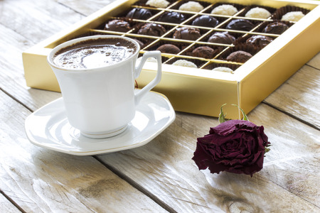 valentines day mother s: Turkish coffee, truffle chocolate and dried rose on wooden table Stock Photo