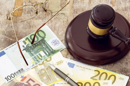 judicature: Law concept, gavel clock and money on wooden table