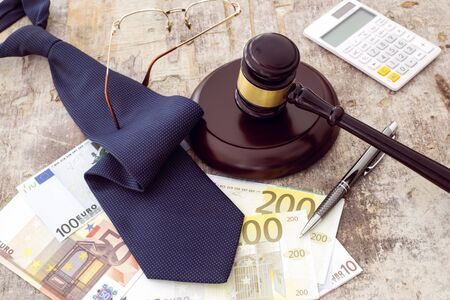 Law concept, gavel clock and money on wooden table