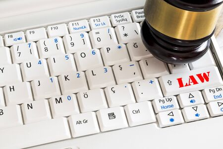 judicature: Law concept. Close up of judge gavel and laptop Stock Photo