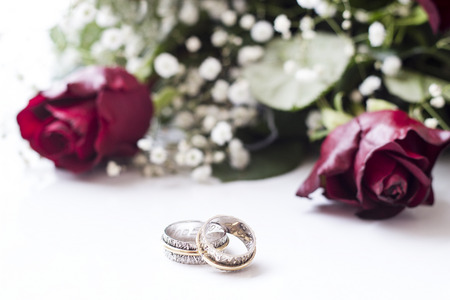 flyaway: Happy Valentines day. Wedding rings and red roses Stock Photo