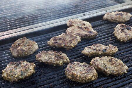 Meatballs on smoking grill. Barbecue in nature Stock Photo