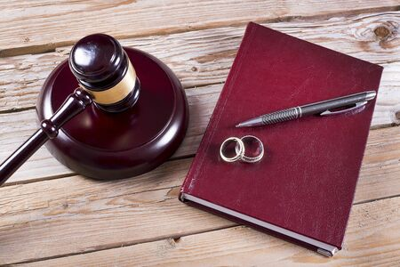 seperation: Family law concept. Gavel, rings and agenda on wooden table