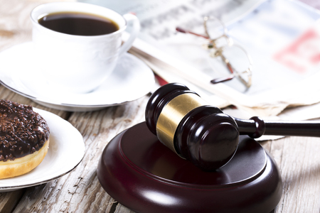 judicature: Family law concept. Gavel, newspaper and coffee on wooden table Stock Photo