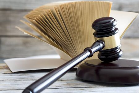 Law concept. Gavel, statue and book Stock Photo