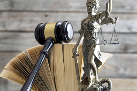 Law concept. Gavel, statue and book Banque d'images