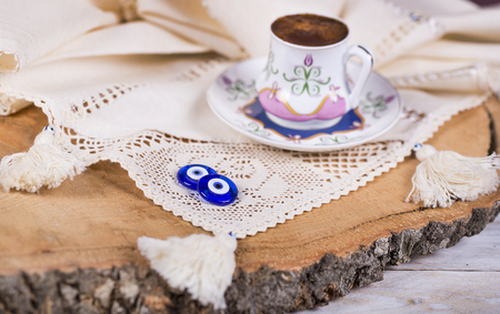 With Turkish coffee amulet beads embroidered on the cloth