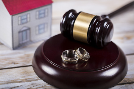 judicature: Family law concept. Divorce. Gavel, house and rings