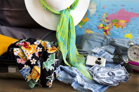 Holiday suitcase and summer accessories. Travel concept Stock Photo