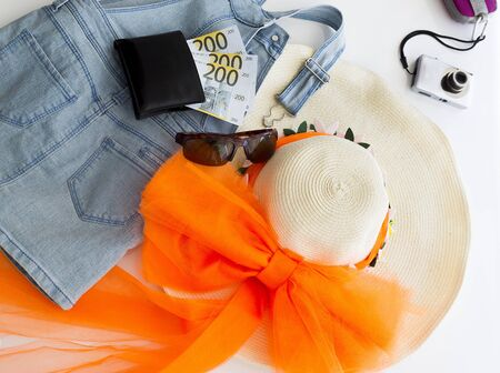 Summer travel vacation concept. Straw hat, money and summer accessories Stock Photo