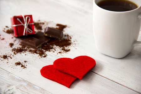 flyaway: Red heart and gift box with chocolate and coffee on wooden table. Valentines day Stock Photo